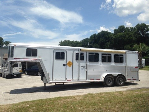 R E D U C E D : 2003 Featherlite (2) horse slant load with an 8' conversion that has an A/C unit, cabinets, closets space,  t.v, microwave, fridge, sink, separate toilet, shower and walk thru door into the horse area!  The horse area has an interior height of 7' tall x 7' wide, This trailer is equipped with an Onan 4000 Generator with a push buttom start in the living quarter!