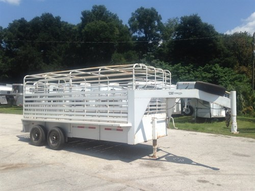 "1998 CM Brush Buster BT 16' stock trailer with an interior height of 7' tall x 6'8"" wide x 16' long,  center gate, hog paneling over all wood floor and double back rear doors!  Spare tire over the neck."