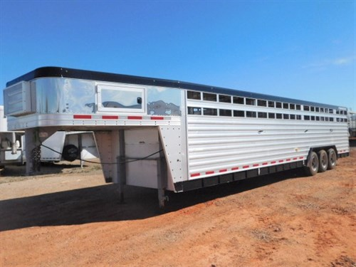 """AD#6005  2013 Featherlite Stock GN 8'X34'X6'6""""3 Center Gates w/Half Sliders, Makes 4 Compartments, Rubber Blank Floor, Escape Door, GN Tack Door, Stainless Steel GN & Nose, Lighted Sign, Painted Top Rail-Bottom Rail & Rear Posts, Dual Jacks, Full Lined & Insulated Roof w/3 Roof Vents, Dble Rear Door, 37,000 lb Axles w/New 235/75 R17.5 18ply Radials, Load Lights. Trailer In Good Condition. Sale Price $29,900.00"""