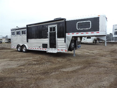 """# 15999 2016 Elite GN 8'X25'X7.5' DLX, 3H w/10'8"""",Sofa-Sleeper At Riser Wall, 2 Burner Recessed Stove, 6 cu. Refg., Microwave, Ducted A/C, Ducted Furnace, Soft Touch Walls & Ceiling, Large Bathroom, Radius Shower w/Glass Doors, Porcelain Stool & Sink, 1 Hat Rack, Hyd Jack, Generator Prep, Awning w/Weather Shield"""