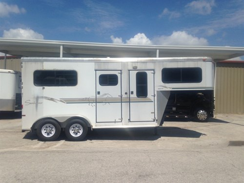 "2003 Sundowner (2) horse straight load trailer with a 4' tack room that has a (2) tier saddle rack, bridle hooks, window in tack room wall and a brush box.  The horse area has an interior height of 7'6"" tall x 7' wide x 16' long,  (2) escape doors,  sliding bus windows along the sides of each horse, roof vents, removable divider, rubber mats over aluminum floor and a rear ramp with dutch doors!   Spare tire.  Very clean!"
