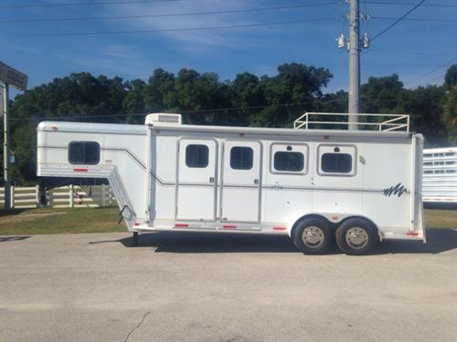2001 SideKick (3) horse slant load living quarter with a 6' conversion that has an A/C unit, insulated roof, 3cu fridge & freezer, sink, microwave, tons of cabinets, closet space, picture window, shower and a walk through door. In the horse area you have an interior height of 7' tall x 7' wide