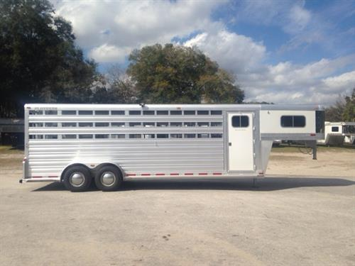 "ON SALE: 2016 Platinum Coach 24' Stock Combo GN Trailer with an interior height of 7'6"" tall x 7' wide x 24' long, tack room with a (4) tier saddle rack, bridle hooks with carpet wall, blanket bar and a brush box,  escape door, (1) full swinging center gates, rubber mats over all aluminum floor, 3 slatted stock sides and double back rear doors!  The exterior has two 7000lbs axles with a spare tire. WAS 26,900 ~ NOW $24,900!!"