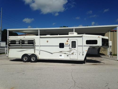 CONSIGNMENT: 2006 Trails West (3) horse living quarter with a 10' conversion that has a Slide Out, A/C unit, furnace, dinette, 6cu fridge & freezer, sink, two burner cooktop, radio, lots of cabinets, large closets and a bathroom.  In the bathroom you have a toilet, shower, sink with a medicine cabinet and a walk thru door into the horse area.  ELECTRIC JACK, SLIDE OUT & GENERATOR!
