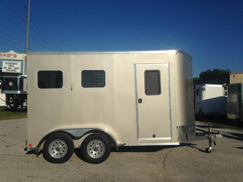"2017 Kiefer (2) horse slant load bumper pull trailer with a large tack room that has saddle racks, bridle hooks and a camper door.  The horse area has an interior height of 7'6"" tall x 7' wide x 14' long, drop down windows at the horses heads, sliding bus windows at the horses hips, roof vents, insulated roof, removable center post with double back rear doors!   Champagne in color."