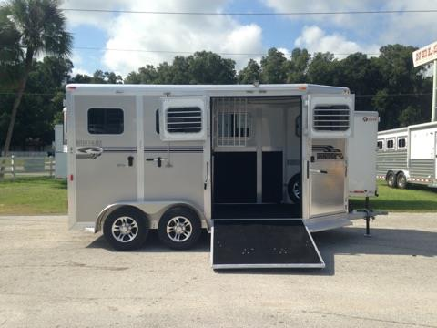 "2017 River Valley Deluxe (2) horse side ramped straight load bumper pull trailer with an interior height of 7'6"" tall x 7' wide x 16' long,  front escape door, (2) removable saddle racks, bridle hooks, drop down windows with drop down aluminum bars, INSULATED ROOF, roof vents, electric fans, air flow head shield, removable divider, RUMBER FLOORING, side ramp with dutch doors and a rear ramp with dutch doors.  The exterior has running boards and aluminum wheels!"