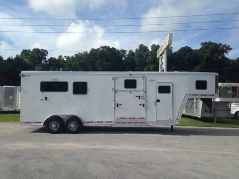 2017 Kiefer Ext (2) + (1) GN Trailer with an interior height of 8' tall x 7' wide x 24' long, tack room with removable saddle racks, bridle hooks, fully lined & insulated, carpet, brush box and a walk thru door into the horse area. In the horse area you have a fully lined & insulated roof, roof vents, escape door with a drop down window, drop down windows at the horses head, side ramp with dutch door, air flow center gates, removable divider, rubber lined & insulated walls,