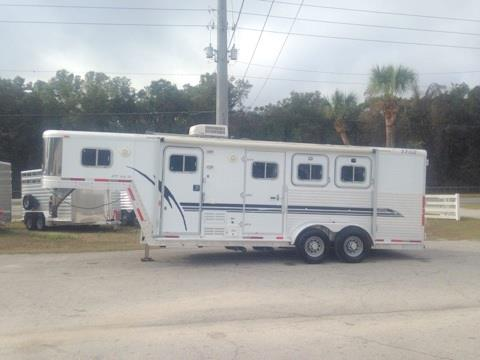 2003 Exiss (3) horse slant load living quarter with a 6' Sierra Conversion with an A/C unit, Dinette that folds into a bed, 3cu fridge & freezer, sink, microwave, cabinets and closets.  The bathroom has a toilet, shower, linen closet and a walk thru door.