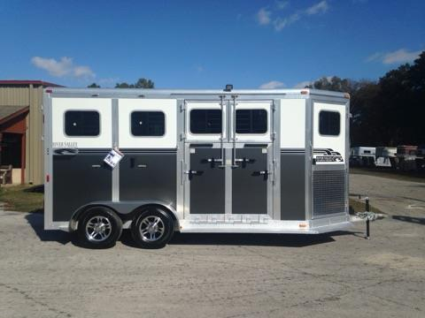 "2017 River Valley Deluxe 18' (2) horse side ramped bumper pull trailer with an interior height of 7'6"" tall x 7' wide x 18' long, tack room with removable saddle racks, bridle hooks and a swinging tack room wall.  The horse area has an interior height at 7'6"" tall x 7' wide x 18' long, escape door with drop down windows, insulated roof, roof vents, removable padded divider , head shield, padded head protection, electric fans, RUMBER FLOORING,"