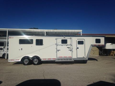 2017 Kiefer Ext (2) + (1) GN Trailer with an interior height of 8' tall x 7' wide x 24' long, tack room with removable saddle racks, bridle hooks, fully lined & insulated, carpet, brush box and a walk thru door into the horse area. In the horse area you have a fully lined & insulated roof, roof vents, escape door with a drop down window, drop down windows at the horses head, side ramp with dutch door, air flow center gates