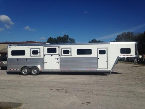 2017 Cimarron (4) horse head to head with a tack room that has (4) removable saddle racks, bridle hooks and a brush box.  The horse area has an interior height of 8' tall x 7' wide x 29' long, insulated roof, roof vents, rubber lined & insulated walls, removable dividers, two center gates with double doors making 3 box stalls, rubber mats over all aluminum floor, escape door, drop down windows with drop down aluminum bars, side ramp with dutch doors and a rear ramp with dutch doors!