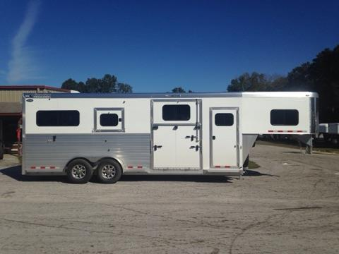NELSONS SPECIAL SALE PRICE! 2017 Cimarron (2+1) trailer with a tack room that has (2) removable saddle racks, bridle hooks and a brush box.  The horse area has an interior height of 8' tall x 7' wide x 24' long, escape door, drop down windows at the horses heads,  side ramp with dutch door, insulated roof, roof vents, center gate with double doors, removable divider, rubber lined & insulated walls, rubber mats over all aluminum floor and a rear ramp with dutch doors!