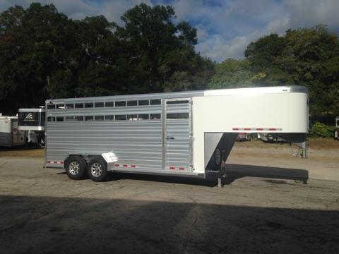 "2017 Cimarron 20' stock trailer with an interior height of 7'6"" tall x 6'10"" wide x 20' long, drop gate over neck, escape door, insulated roof, full swinging center gate with a slam latch, Extruded aluminum interlocking floor with cross members at 4? centers and traction grooves, solid extruded aluminum interlocking side walls, plexi-glass tracks, tie rail running full length of the trailer on both sides and a full swinging rear door with a half slider that has a heavy duty cam-lock latch!"