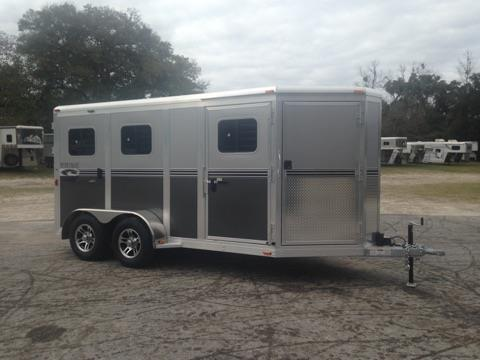 2017 River Valley Low Profile 6 pen trailer with a front tack area, interior height of 6' tall x 7' wide, sliding bus windows along the sides, insulated roof, roof vents, makes into 6 pens or 3 larger pens, curbside escape door and  a rear ramp with dutch doors. The exterior has aluminum wheels and a spare tire.