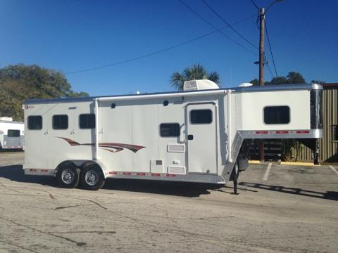 2017 Kiefer (3) horse slant load with an 8' conversion that has an A/C unit, furnace, couch, two burner cooktop, sink, cabinets, closets, microwave, 3cu fridge and a freezer! The bathroom has a shower, toilet, sink with medicine cabinet, linen closet and a walk thru door.