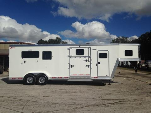 2017 Kiefer (2+1) GN Trailer with an additional removable divider in the front box stall, tack room with saddle racks, bridle hooks, insulated roof, brush box, walk thru door and a camper door!  The horse area has an interior height of 8' tall x 7' wide x 24' long, escape door with a drop down window, side ramp with two dutch doors, hauls up to 4 horses, makes into two box stalls, center gate, rubber mats over all aluminum floor, rear ramp with dutch doors!
