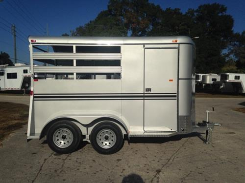 2017 Bee (2) horse slant load bumper pull trailer with a 4' dressing room that has a (2) tier removable saddle rack, bridle hooks and a spare tire! The horse area has an interior height of 7' tall x 6' wide x 14' long, escape door, stock type sides, rubber mats over wood floor and a full swinging rear door! LIFETIME WARRANTY on the trailer floor!!!! Silver in color!