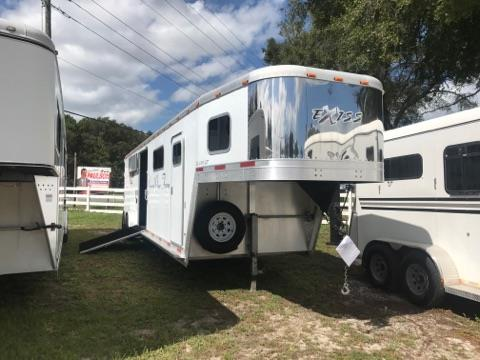 "2006 Exiss (4) horse head to head trailer with a 4' tack room that has saddle racks, bridle hooks and a brush box.  The horse area has an interior height of 7'6"" tall x 7' wide x 29' long,  escape door, side ramp with dutch doors, removable dividers, rubber mats over all aluminum floor and a rear ramp with dutch doors!  The exterior has two 7000lbs axles and a spare tire."