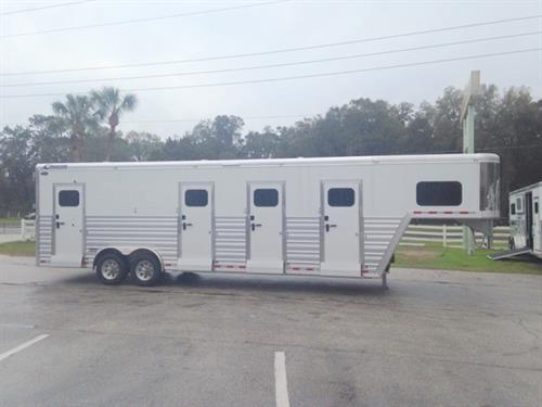 2017 Cimarron (3) box stall trailer with a tack room that has bridle hooks and a brush box.  The horse area has an interior height of 8' tall x 8' wide x 28' long, (3) box stalls, (3) curbside access doors with chest bars and fold down steps, insulated roof, roof vents, rubber lined and insulated walls,(2) full swinging center gates, sliding bus windows along the sides of each box stall, rubber mats over all aluminum floor and a rear ramp with dutch doors!