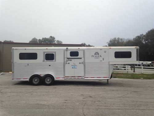 "2012 Adam (4) horse head to head trailer with a tack room that has saddle racks and bridle hooks. The horse area has an interior height of 7'6"" tall x 7' wide x 23' Long, escape door, drop down windows with drop down aluminum bars, roof vents, removable dividers, side ramp with a dutch door, WERM FLOORING and a rear ramp with dutch doors! Spare tire included, in excellent condition! Recently serviced with BRAND NEW BRAKES, DRUMS and BEARINGS!"