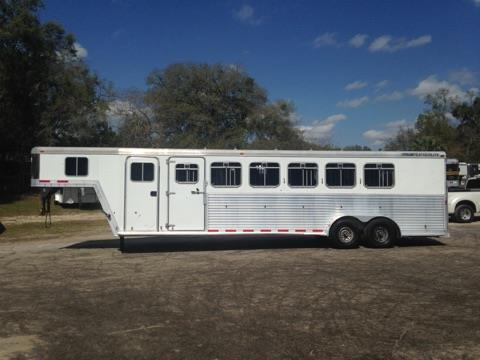 2001 Feathelite (6) horse slant load trailer with a tack room and bridle hooks.  The horse area has an interior height of 7' tall x 7' wide, escape door, drop down windows at the horses heads with drop down aluminum bars, sliding bus windows at the horses hips, roof vents, rubber lined walls, rubber mats over all aluminum floor, rear collapsible tack room with double back rear doors and a rear ramp.