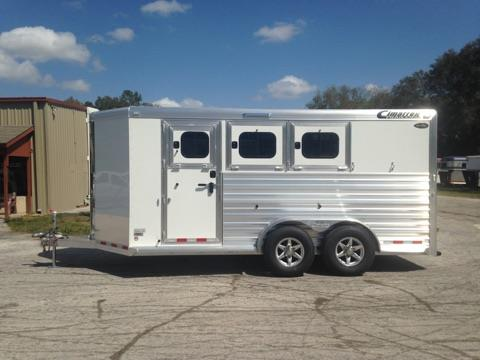 "2017 Cimarron (3) horse slant load bumper pull trailer with a tack room that has a swing out (3) tier saddle rack, bridle hooks, clothe bar, 25 gallon water tank, pad rack and a brush box.   The horse area has an interior height of 7'6"" tall x 7' wide, insulated roof, roof vents, escape door, drop down windows at the horses heads, slatted stock sides at the horses hips, plexi-glass inserts, rubber lined & insulated walls, rubber mats over all aluminum floor and double back rear doors!"
