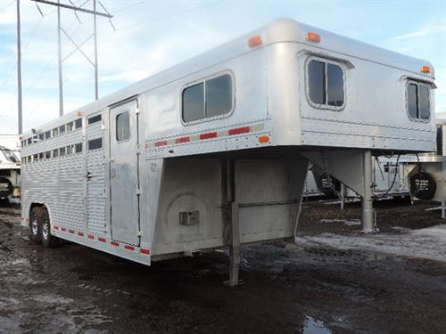 #13683 1992 4Star GN 8'x22'x7' - stock combo, 4ft dressing room, carpet GN and floor, GN windows, double rear doors, escape door, load lights, front full stud gate, center gate, stock back w/storage compartment, 8000 lb axles, 235/85 R16 14 ply radials, stainless steel simulators - Good condition! **SALE PRICE** $9850.00