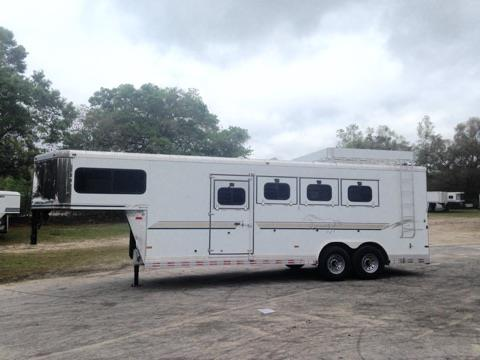 "CONSIGNMENT:  2004 Sundowner (4) horse slant load with a tack room that is fully insulated, crank up roof vent, bridle hooks, area for a (4) tier saddle rack and a brush box.  The horse area has an interior height of 7'6"" tall x 8' wide, escape door, drop down windows at the horses heads, sliding bus windows at the horses hips, insulated roof, roof vents, electric fans at the horses hips, rear collapsible tack room with a (4) tier swing out saddle rack,"