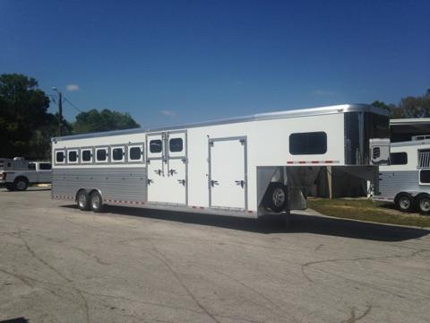 "2017 Cimarron (8) horse slant load with a tack room that has bridle hooks, area for saddle racks, an access door and a side ramp.  In the horse area you have an interior height of 8' tall x 8'4"" wide x 35' long, escape door with a drop down window and drop down aluminum bars,  drop down windows at the horses heads and hips with drop down aluminum bars at the horses heads, insulated roof, roof vents, rubber lined and insulated walls, rubber mats over all aluminum floor,"