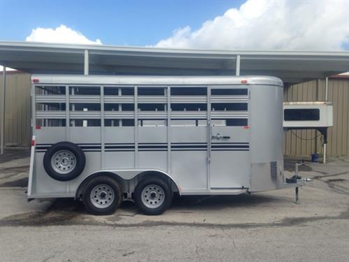 2017 Bee 16' stock bumper pull trailer with an interior height of 7' tall x 6' wide x 16' long, spare tire, full escape door, center gate, rubber mats over wood floor and a full swinging rear door with a half slider! LIFETIME WARRANTY on the Floor! Silver in color!