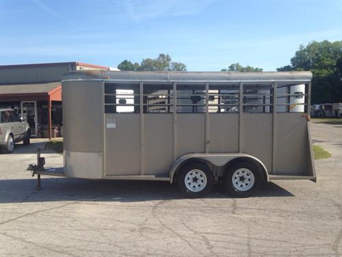 2004 Bee 16' stock bumper pull trailer with an interior height of 7' tall x 6' wide x 16' long, escape door, center gate, rubber mats, wood floor and a full swinging rear door with half slider!  The exterior has two 3500lbs axles with a spare tire.
