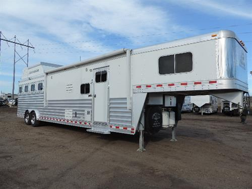 "#14185 2014 Elite GN 8'x33'x7'6"" Tall DLX 4 horse w/15' Trail boss custom LQ, HWH hyd jack,  6 FT slide out w/sofa sleeper, solid knotty alder, corner booth, 6 cu. refrigerator, recessed 2 burner stove w/flip up countertop, flip up counter, convection – microwave, 2 TV's w/ DVD's & dish receivers, satellite receiver, AM-FM-CD player, pocket door, raised panel cabinets, large vanity w/porcelain sink"