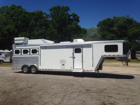 2017 Cimarron (3) horse living quarter with a 13' Trail Boss Conversion that has ducted air conditioning, furnace, corner chair, couch, (2) burner cooktop, sink, convection oven, stereo system with indoor/outdoor speakers, T.V.,  cabinets, large closet under T.V, and a huge bathroom!  In the bathroom you have a toilet, radius shower, sink with medicine cabinet, double hanging closet, linen closet and a walk thru door into the horse area.  EQUIPPED WITH AN ONAN 4000 GENERATOR!!!