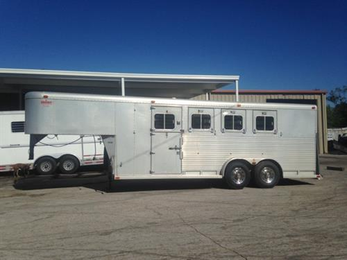 1991 Sooner (4) horse slant load trailer with a tack room that has an insulated roof, bridle hooks, saddle racks and a brush box.  The horse area has an interior height of 7' tall x 7' wide, escape door with a dutch door, drop down windows at the horses heads, slatted stock sides at the horses hips, full divider making two box stalls, rubber mats over all aluminum floor and double back rear doors with a rear ramp!