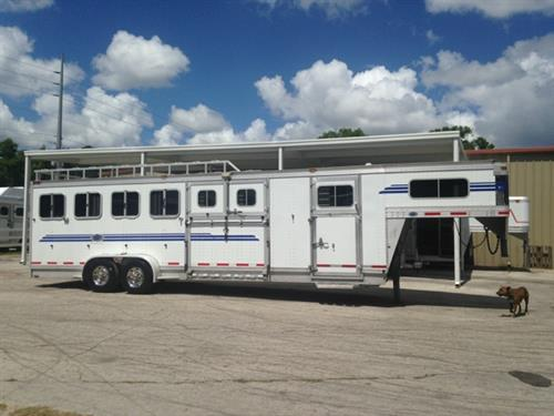 "2009 EBY (7) horse slant load with storage over the nose, escape door with a dutch door, curbside ramp for stalls 1 & 2 with dutch doors, drop down windows at the horses heads and hips, 7'5"" tall x 7' wide, insulated roof, rubber lined & insulated walls, makes into (3) box stalls, rubber mats over all aluminum floor and double back rear doors with a rear ramp!  The exterior has a hayrack."