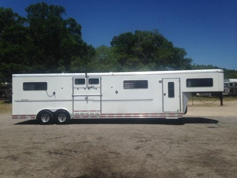 "2008 Shadow (6) horse head to head trailer with a tack room that has a (4) tier removable saddle rack, bridle hooks, insulated roof and a brush box.  The horse area has an interior height of 7'6"" tall x 8' wide, escape door with a drop down window, insulated roof, roof vents, removable dividers, makes into (3) box stalls, side ramp with dutch doors, rubber mats over aluminum floor and a rear ramp with dutch doors!  Spare tire."