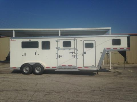 "CONSIGNMENT: 2015 Kiefer (2+1) GN Trailer with a tack room that has removable saddle racks, bridle hooks, brush box, camper door and a walk thru door into the horse area. The horse area has an interior height of 7'6"" tall x 7'wide, escape door with a drop down window, additional drop down windows at the horses heads, roof vents, removable air flow center gate, removable divider, rubber mats over all aluminum floor and a rear ramp with dutch doors! Spare tire"