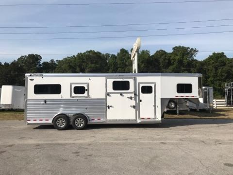 2017 Cimarron (2+1) GN Trailer with a tack room that has a (3) tier saddle racks, bridle hooks, brush box and insulated roof.  The horse area has an interior height of 8' tall x 7' wide x 22' long, makes into two box stalls – 8' box stalls, escape door with a drop down window, side ramp with dutch door, rubber lined & insulated walls, rubber mats over all aluminum floor, double airflow gates, removable divider, rear ramp with dutch doors!  The exterior has aluminum wheels and a spare tire.