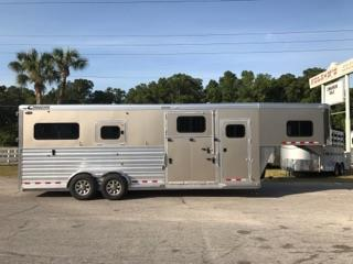 2017 Cimarron (2+1) GN Trailer with a tack room that has a (3) tier saddle racks, bridle hooks, brush box and insulated roof.  The horse area has an interior height of 8' tall x 7' wide x 24' long, makes into two box stalls – 10' box stalls, escape door with a drop down window, side ramp with dutch door, rubber lined & insulated walls, rubber mats over all aluminum floor, double airflow gates, removable divider, rear ramp with dutch doors!  The exterior has aluminum wheels and a spare tire.