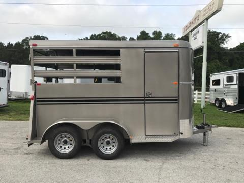 2017 Bee (2) horse slant load bumper pull trailer with a 4' dressing room that has a (2) tier removable saddle rack, bridle hooks and a spare tire! The horse area has an interior height of 7' tall x 6' wide x 14' long, escape door, stock type sides, rubber mats over wood floor and a full swinging rear door! LIFETIME WARRANTY on the trailer floor!!!! Beige in color!