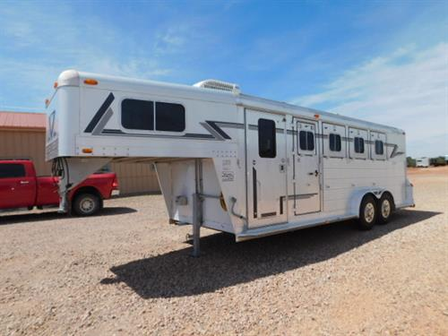 AD#4327 1993 4Star GN 7' X 22' X 7' 4 Horse DLX, Weekend Package, AC/Heat Unit, Microwave, TV, Carpeted GN-Drop, Lots Of Cabinets For Storage, Full Nose-Cabinets, Camper Door W/Screen, Collapsible Rear Tack, 4 Tier Removable Saddle Rack, 2 Brush Trays, Aluminum Bridle Hooks, Padded Slam Latch Dividers, Stud Divider, Rubber Lined Walls, Rubber Mats, 4 Drop Down Windows W/Screens, 4 Drop Down Windows On Rump Wall, Escape Door