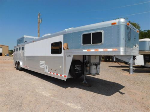 "AD#3799 2003 C&C GN 8' X 31' X 7'6"", 4 Horse W/13' LQ, South Western Conversion, Privacy Wall For Bed In GN, Dinette, Sofa-Sleeper, 6 Cu. Fridge, Microwave, Entertainment Center W/TV-DVD Player, Satellite, Remote Control AC/Heat, Ducted AC, Ducted Furnace, Large Closet In Bathroom W/Rods, Stool, Radius Shower, Large Vanity W/Sink, Cowhide On Cabinet Doors, Soft Touch Walls & Ceiling, Outside Boot Box By Step"