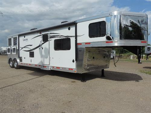 "#00787 2015 Lakota Charger 8'x26'x7'6"" tall, all aluminum, 2 Horse, GN, 15' LQ, 6' slide out, sofa and full dinette, entertainment package 1/32' TV, DVD-CD-AM-FM player, interior/exterior speaks, rear kitchen with bar and stools, 6 cubic refrigerator, double stainless steel sink.... SALE PRICE 42,500.00"