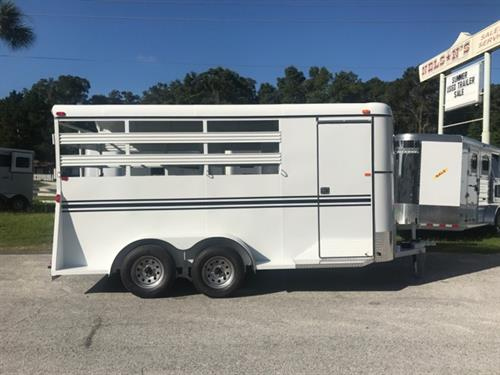 2018 Bee (3) horse slant load bumper pull trailer with a 4' dressing room that has a (3) tier removable saddle rack, bridle hooks and a spare tire! The horse area has an interior height of 7' tall x 6' wide x 16' long, escape door, stock type sides, rubber mats over wood floor and a full swinging rear door and a rear ramp! LIFETIME WARRANTY on the trailer floor!!!! White in color!