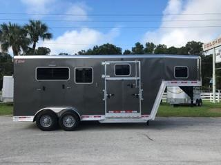 "2018 Kiefer (2+1) GN Trailer with an interior height of 8' tall x 7'2"" wide, drop gate over neck, insulated roof, escape door with a drop down window and aluminum bars, additional drop down windows and aluminum bars at each horses heads, roof vents, full swinging center gate, rubber mats over all aluminum floor, side ramp with dutch doors and a rear ramp with dutch doors.  The exterior has a hydraulic jack and spare tire."