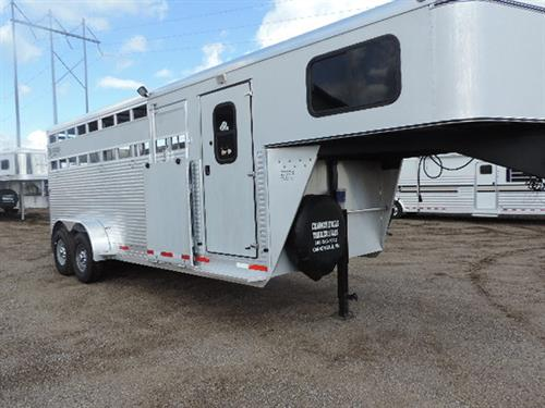 #73989 2013 Shadow GN 7'x20'x7' tall stock/combo, 4' dress room, GN windows, carpet GN and drop, rubber mat dress room and stock area, escape door street side and curbside w/side unload ramp c/s, time rail inside s/s, outside ties high and low, full open with half slider rear door, 2 LED load lights, new 235/85R16 14 ply radials. Sale Price $17,500.00