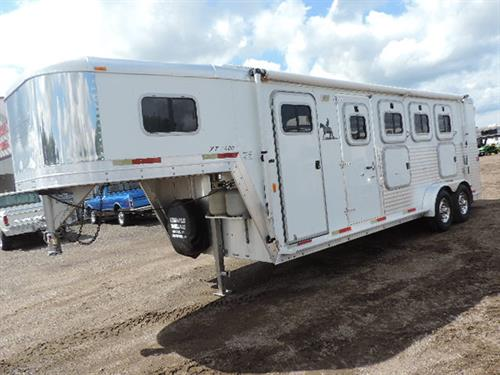 2003 Exiss GN 7'X22'X7' Event XT400, 4 Horse, 5ft to 9ft finished weekender, lined and insulated, 3.5 cu refrigerator, 2 burner stove, microwave, a/c, water heater, awning, nice cabinets and closets, escape door w/drop down feed door, 3 mangers w/2 manger doors, fold down bars, 40/60 rear doors w/windows, carpeted rear tack w/ 4 tier saddle racks, slam latch dividers.