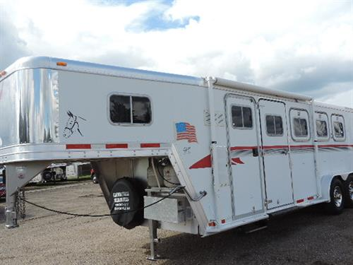 #14617  1998 Featherlite GN 7'x22'x7' 4 Horse, 5 ft short wall, finished, lined, and insulated dressing room, 2 burner stove, boot bench, furnace, 110 volt power converter, 4 cu refrigerator, battery package, awning, escape door, drop down feed doors, padded dividers, insulated roof and side walls horse area, carpeted collapsible rear tack, 4 swing out saddle racks, 235/85R 16 10 ply radials