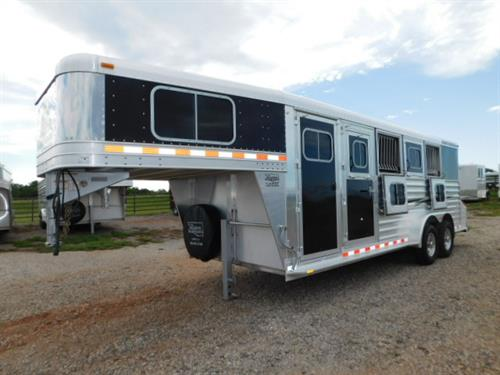 """AD#13841 2013 Elite Mustang GN 7' X 21' X 7', 4 Horse W/3'6"""" To 7'6"""" Dress Room, Carpeted GN-Drop-Floor, Movable 4 Tier Saddle Rack (Rear Tack To Dress Room), Windows In GN, Blanket Bar, Brush Tray, 4 Drop Down Windows W/Fold Down Bars, 4 Drop Down Windows On Rump Side, Escape Door, Padded Dividers, Removable Stud Panel, Rubber Lined Walls, Rubber Floor Mats, Collapsible Rear Tack"""