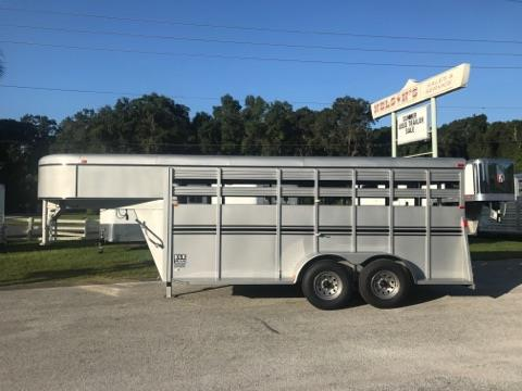 "2018 Bee 16' stock trailer with an interior height of 6' 6"" tall x 6' 6"" wide x 16' long,  drop gate over neck, escape door, full swinging center gate, wood floor and double back rear doors!  The exterior has two 5200lbs axles and a spare tire.  Lifetime Warranty on Floor!"
